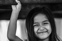 Portrait of a smiling little girl,black&white (By Jan_) Tags: pink summer portrait baby sunlight white black green nature girl face grass smiling closeup landscape asian thailand kid funny asia long child little outdoor background joy daughter lawn lifestyle happiness thai joyful lying cutegirl summerday happinesshair