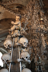 Dusty angel (waitscm) Tags: angel skull cobweb chandelier ossuary kutnahora bone sedlec bonechurch