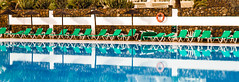 Too Cold for swimming today! (fatboydon) Tags: blue cactus green pool swim reflections chairs beds shades lounger sunbed lifebouy
