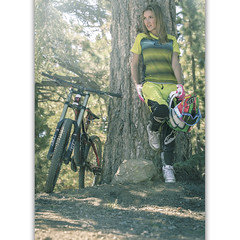 Big Bear Mountain Resorts Bike Park at Snow Summit in Big Bear Lake, California. Girl Rider resting in the shade.