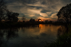 Autumn clouds (piotrekfil) Tags: trees sunset reflection nature water clouds river dark landscape cloudy poland piotrfil