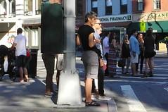 bishop's  crook (omoo) Tags: newyorkcity girls people woman sunlight beautiful women crowd streetscene greenwichvillage redlightgreenlight menandwomen dscn3011 newyorkwoman bishopscrooklamppost saturdaycrowd lamppostsshadow w10thandsixthavenue