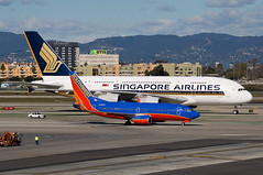 13-343 (George Hamlin) Tags: california mountains southwest buildings photography photo george los airport singapore ramp angeles aircraft international airbus a380 hotels boeing lax airlines decor hamlin 737700 n719sw 9vskg