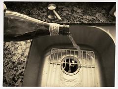 Taking The Pledge (MPnormaleye) Tags: bw water kitchen monochrome strange weird blackwhite bottle counter sink textures liquor utata marble pour bizarre utata:project=downwithit