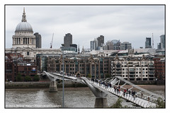 Some Walking Toward St. Paul's, Some Walking Toward Me at the Tate Modern (Doyle Wesley Walls) Tags: lagniappe 0096 river bridge buildings city dome cathedral people photograph milleniumbridge londonengland thethames stpaul'scathedral doylewesleywalls