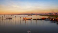 PROMISE OF A NEW DAY (jopetsy) Tags: alabang muntinlupa philippines sunrise fish boat landscape landscapes seascape seascapes lake bridge log