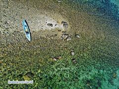 Beached (Ningaloo.) Tags: ladies kite abstract island bay kevin kayak eagle rocky aerial kap guernsey marooned lajoie aeriali kevinlajoie