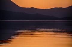 Opposites (Melissa Maples) Tags: sunset summer orange lake mountains reflection water turkey hotel evening nikon asia sundown dusk trkiye nikkor vr afs  18200mm  f3556g atapark  beyehir 18200mmf3556g d5100