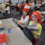 Elementary students pose in Cat in the Hat hats