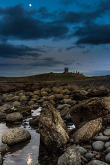 Dunstanburgh Moonlight (trewerynj) Tags: sea moon seascape castle canon reflections landscape eos coast rocks coastal moonlight dunstanburgh