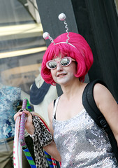 Alien Woman with Pink Hair (shaire productions) Tags: sf sanfrancisco street pink people urban woman smiling festival lady female hair fun person photography photo costume women funny image candid space character alien humor fair odd event photograph wig moment creature antennae imagery howweird howweirdstreetfaire
