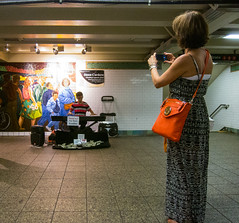 Subway Shooter (UrbanphotoZ) Tags: nyc newyorkcity musician orange woman ny newyork bag keyboard mural photographer dress manhattan mosaic midtown timessquare mk pocketbook michaelkors thereturnofspring jackbeal stphotographia thankyouforyourdonation jasoncordero