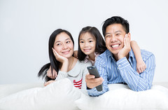 Asian Family Sitting On Sofa Watching TV (anekphoto) Tags: family people woman male men girl television smiling female laughing children mom asian thailand happy person hongkong living tv thirties kid women asia dad sitting child adult room indian father lounge watching daughter chinese mother son indoors sofa mum parent together thai remote laughter remotecontrol relaxed forties enjoyment twenties threepeople