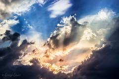 RLHG Puesta de sol 02 (Ricardo Lanas photography) Tags: nubes puestadesol rayos 2014 dng beamsofthesun