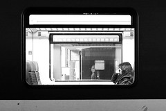Window (Transformer18) Tags: life street city trip travel light portrait people urban blackandwhite bw woman white black art window face train switzerland photo spring europe day alone photographer darkness photos live surreal olympus basel inside 20mm arrival monochrom intercity metropole em5 focuspocus flickriver