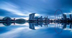 The Blue Rush (WhatAGoodName) Tags: city longexposure blue sunset canon reflections landscape flyer singapore cityscape dramatic hour mbs 10stop leefilter gardensbythebay bigstopper