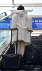 Immigration (Ctuna8162) Tags: travel chicago girl asian penguin illinois outfit airport escalator ohare suitcase traveler