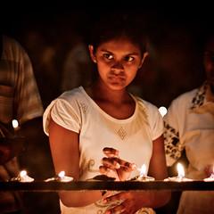 ... (Malinthe Samarakoon) Tags: people night portraits lowlight expressions srilanka lamps emotions kandy oillamps poya claylamps