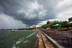 somewhere (local paparazzi (isthmusportrait.com)) Tags: light summer sky lake distortion storm green water skyline contrast umbrella buildings campus table prime iso800 pier dangerous dock pod nikon colorful waves pattern chairs cloudy unique grain wide perspective july windy overcast wideangle stormy line patio adapter uwmadison thunderstorm summertime manual madisonwi tradition nikkor noise 35 gusty brightness edgewater ais picnictable memorialunion 18mm lakemendota redgym 2014 rectilinear unionterrace isthmus summerstorm vello stormcell edgewaterhotel nikonfmount danecountywisconsin nikontocanon canon5dmarkii utlrawide localpaparazzi redskyrocketman lopaps nikon18mm35ais isthmusportrait velloadapter
