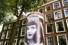Ed is watching (Arne Kuilman) Tags: woman bus film netherlands amsterdam 35mm poster photographer nederland tentoonstelling fotograaf stadsarchief edvanderelsken reclamezuil