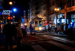 night trolley (JimfromCanada) Tags: trolley tram sanfrancisco night evening shop crowd rail light reflection headlight vintage heritage old preserved hectic shopper shopping shoppers store street city downtown track transportation