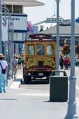 San Francisco - NOT a cable car at Fisherman's Wharf (MikePScott) Tags: sanfrancisco california road street camera usa bus lens highway streetlight boulevard unitedstates motorway streetlamp pavement flags sidewalk lamppost freeway avenue builtenvironment nikond600 nikon28300mmf3556 featureslandmarks