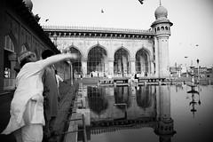 IMG_1958 (Deepthi Ghalke) Tags: old city morning people bw white black building heritage birds architecture hall pigeon muslim prayer hyderabad mecca masjid charminar nizam