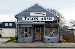 Talon Arms (stephen trinder) Tags: newzealand christchurch shop landscape arms rifle nz guns shotgun kiwi damaged deserted shopfront dilapidated linwood barred gunshop barredwindows christchurchnewzealand