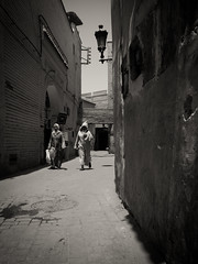 Street Scene, Marrakech (alexstanhope) Tags: africa street city travel monochrome alley african streetphotography arabic morocco arab alleyway marrakech maghreb morrocan