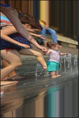 Reaching Out (swong95765) Tags: motion wet water fountain horizontal kid reaching zoom action perspective warp contact waterjet