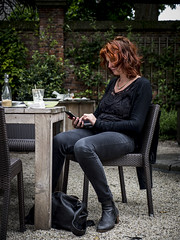 Hanneke, Leiden 2014: Quality check (mdiepraam) Tags: portrait woman girl beautiful dutch leather lady bag table leiden necklace chair pretty boots gorgeous samsung curls redhead jeans smartphone mature attractive denim elegant milf hortusbotanicus hanneke blacktop classy 2014 fortysomething