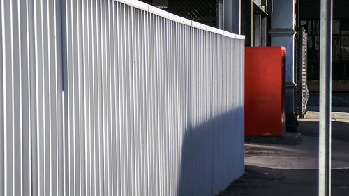 White Fence Red Cabinet