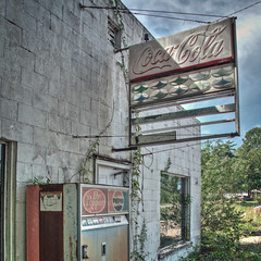Aftermath of the Cola Wars (StGrundy) Tags: old usa signs mountains building abandoned sign architecture rural georgia advertising weeds nikon closed unitedstates decay south cleveland country coke architectural gasstation drpepper southern faded weathered pepsi pepsicola cocacola advertisements derelict vending blueridgemountains hdr decayed smalltown outofbusiness northgeorgia sodamachine appalachianmountains appalachians vintagesign fillingstat