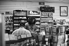 248/365 (local paparazzi (isthmusportrait.com)) Tags: people blackandwhite bw white black detail blancoynegro blanco strange contrast person eos 50mm pod downtown raw dof looking bokeh good unique f14 candid interior negro watching grain perspective clarity business hidden indoors odd camel human newport fancy marlboro wise usm madisonwi poison choices noise sales statestreet ef pleasure levels counting fbi iso1600 peoplewatching options menthol lethal 2014 transaction sharpness secretive onlooker canonraw isthmus trianglemarket 50mmf14usm 365project danecountywisconsin photoshopelements7 canon5dmarkii pse7 localpaparazzi redskyrocketman lopaps isthmusportrait