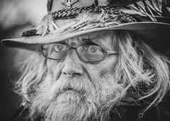mountain man (andy_8357) Tags: pearl st street mall boulder colorado mountain man beard glasses hat feathers elderly old people person sony ilce6000 a6000 ilcenex alpha nikon 105mm f25 ai mirrorless authentic character long hair winter rugged silver blackandwhite black white blancoynegro blanco y negro blanc noir 10525ai 10525 nikkor retrato