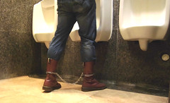 Doc Martens 14 eyes Cherry Red in leg irons (asiancuffs) Tags: handcuffs handcuffed arrest arrested inmate prisoner shackles shackled