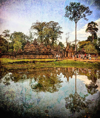 Lake view of Banteay Srei Temple entrance with grunge (Neville Wootton Photography) Tags: ankorarchaeologicalpark banteaysreitemple cambodia grunge holidays lakescapes mangojouneys reflections topazlabs