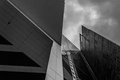 (McQuaide Photography (Away)) Tags: city blackandwhite bw holland building netherlands monochrome amsterdam architecture canon eos blackwhite europe nederland structure dslr modernistarchitecture modernarchitecture stad 100d mcquaidephotography