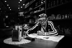 Two glasses is better than one (Giulio Magnifico) Tags: lighting old glass composition vintage relax glasses newspaper alone loneliness shadows blind wine character memories citylife thoughtful streetphotography streetportrait aged bonnet gaze glance osteria genuine udine nikond800e sigma35mmf14dghsm