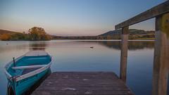 Llangorse Lake (Tim McDonnell) Tags: plants sun lake wales sunrise canon golden boat glare hour 5d brecon beacons edit lightroom llangorse