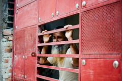 The Watchful Eyes (Sheikh Shahriar Ahmed) Tags: street old man building digital beard nikon gate securityguard candid guard streetlife security dhaka residential bangladesh banasree candidportrait dhakadivision sheikhshahriarahmed