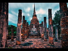 Finding Happiness at Sukhothai, Thailand (Sam Antonio Photography) Tags: nightphotography blue sky monument architecture thailand religious temple happy twilight asia southeastasia peace bangkok buddha stupa buddhist prayer religion peaceful happiness buddhism landmark thai figure historical meditation bluehour sight spiritual wat siam buddhisttemple sukhothai chedi northernthailand travelphotography traveldestinations famousplace watsasi placeofinterest thailandtravel objectofinterest asiatravel photographytips sukhothaihistoricalpark watsrasri watsrasi samantonio ceylonesestile mueangkhao