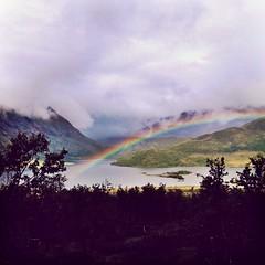 Rainbow. Jotunheimen, Norway (Juliusumulius) Tags: blue red mountains green nature beautiful yellow norway clouds rainbow colours jo mysterious jotunheimen besseggen bessheim