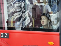 deep in reflection (A-cat-and-a-half) Tags: street greatbritain people colour reflection london window asian sadness ipod streetphotography melancholy stpaulscathedral earplugs fleetstreet doubledecker throughthelookingglass cheapside