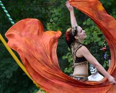 Belly dancer - Orange swirl (albionphoto) Tags: woman usa ny girl dance cosplay bellydancer parrot dancer fairy tuxedo parasol blacksmith faerie renaissancefair volumnia sterlingforest vixensengarde