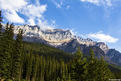 Mountains above Moraine (isaac.borrego) Tags: trees sky canada mountains clouds forest alberta rockymountains banffnationalpark morainelake canonrebelt4i