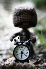 Time goes by too fast (zwanzigzoll) Tags: old light shadow sea black game clock broken water stone canon germany lost eos hope 50mm big sad emotion time little d live go fast away running run sharp 400 planet lonely waste 18 lose rim losing sackboy