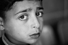 The Syrian children are crying alone (Giulio Magnifico) Tags: life lighting closeup composition contrast hospital turkey lost bigeyes intense eyes war alone loneliness shadows child emotion expression refugee fear border young streetportrait sharp desperate confused syria essence gaze glance reportage genuine kilis photoreportage nikond800e nikkormicro105mmafsvrf28