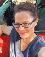 Out with Red, doin some back road exploration. 🌲🌻🌳 (brandyblakley) Tags: womenwithglasses truckgirl arizonagirl arizona drivingthosebackroads getoutandexplore agirlandhertruck happygirl brighteyes hazeleyes girlinglasses freckles redhead instagramapp square squareformat iphoneography