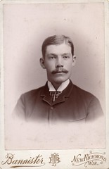 img051 Unknown - Man with Moustache - New Richmond, Wisconsin - Bannister (Witty Girl) Tags: bannister newrichmond wisconsin portrait inside 1890s man unidentified historic old swansonlarsenlee